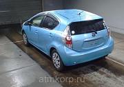 Японский автомобиль хэтчбек гибрид TOYOTA AQUA Москва