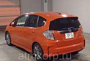 Хэтчбек HONDA FIT кузов GE8 модификация RS год выпуска 2011 пробег 104 тыс км цвет ярко оранжевый Москва